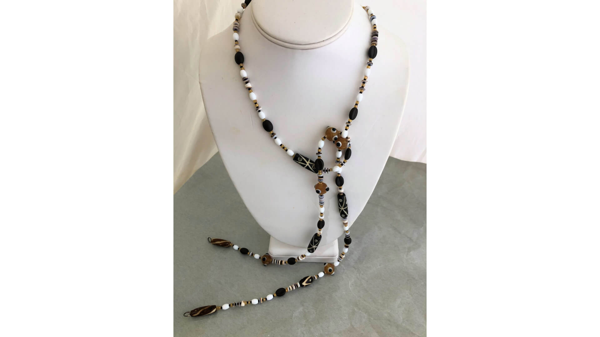 Brown, Black, and White Beaded Lariat Necklace by Susan Hazer Designs