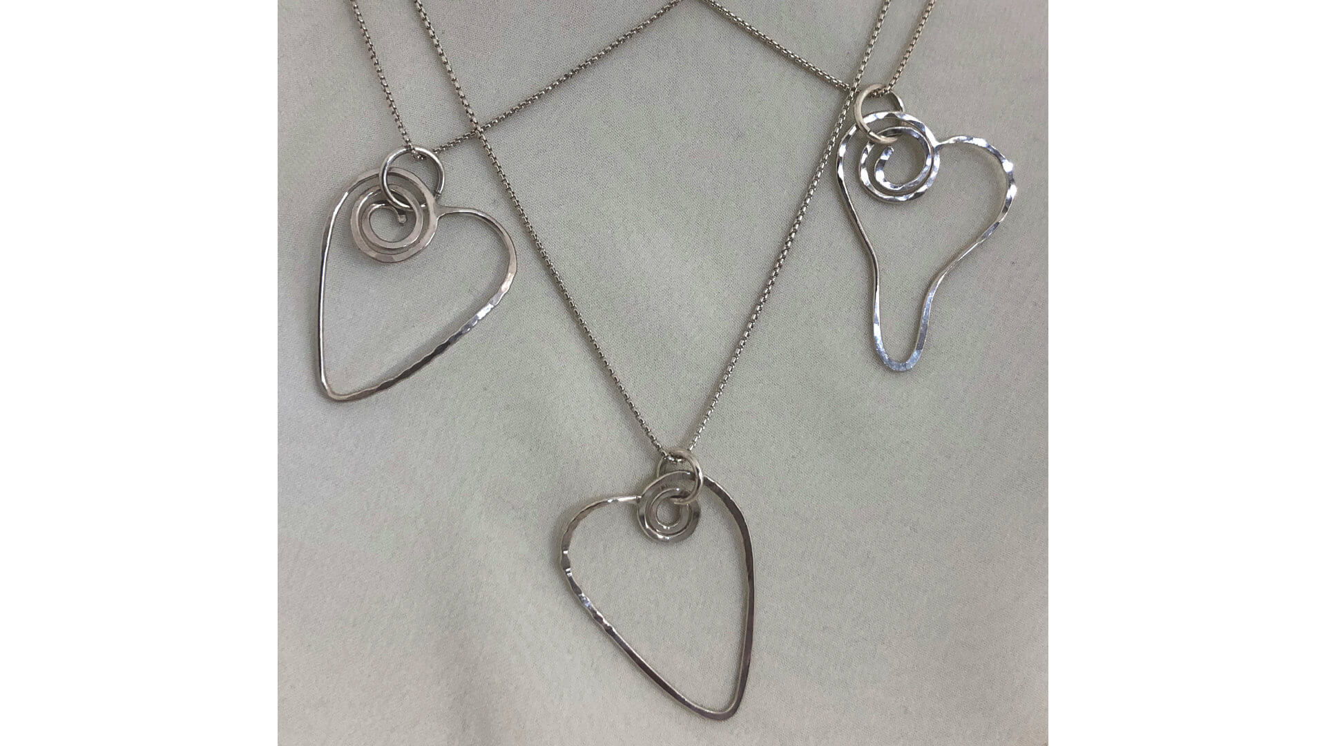 Swirling Heart Energy Pendants by Susan Hazer Designs